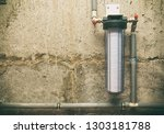 a band new water filter with... | Shutterstock . vector #1303181788