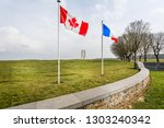 canadian and french flags... | Shutterstock . vector #1303240342
