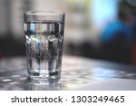 glass of cold mineral water on... | Shutterstock . vector #1303249465