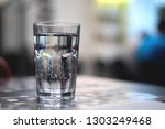 glass of cold mineral water on... | Shutterstock . vector #1303249468