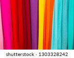 colorful fabrics on the counter ... | Shutterstock . vector #1303328242
