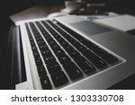office desk table with notebook ... | Shutterstock . vector #1303330708