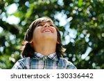 portrait of a cute kid outdoor | Shutterstock . vector #130336442
