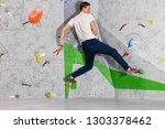 rock climber man hanging on a... | Shutterstock . vector #1303378462