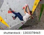 rock climber man hanging on a... | Shutterstock . vector #1303378465