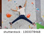 climber man hanging in a twine... | Shutterstock . vector #1303378468