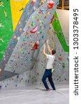 climber explores and develops a ... | Shutterstock . vector #1303378495