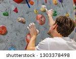 climber explores and develops a ... | Shutterstock . vector #1303378498