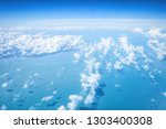 ariel view cloudscape over sea... | Shutterstock . vector #1303400308