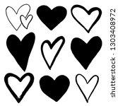 set of black hand drawn hearts... | Shutterstock .eps vector #1303408972