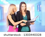 two girls in the office with...   Shutterstock . vector #1303440328