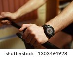 close up of sweaty man arm with ...   Shutterstock . vector #1303464928