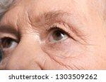 wrinkled face of elderly woman  ... | Shutterstock . vector #1303509262