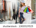 woman with shopping bags in the ... | Shutterstock . vector #1303519525