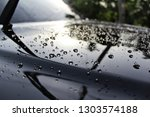 water droplet on car hood after ... | Shutterstock . vector #1303574188