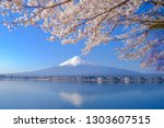 mount fuji with snow capped ... | Shutterstock . vector #1303607515