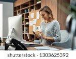 beautiful smiling woman reading ...   Shutterstock . vector #1303625392