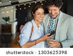 smiling mature couple embracing ... | Shutterstock . vector #1303625398