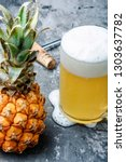 glass with eya with pineapple... | Shutterstock . vector #1303637782