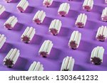 colorful marshmallow is laid... | Shutterstock . vector #1303641232