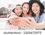 trendy asian girls making video ... | Shutterstock . vector #1303672975