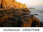 cliffs on the beautiful coast... | Shutterstock . vector #1303679068