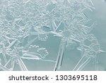 snow patterns on glass as an... | Shutterstock . vector #1303695118