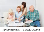 family with seniors couple... | Shutterstock . vector #1303700245