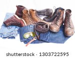 man's accessories and jeans | Shutterstock . vector #1303722595