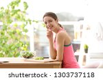 young woman in fitness clothes...   Shutterstock . vector #1303737118