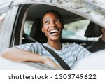 cheerful woman in a car | Shutterstock . vector #1303749622