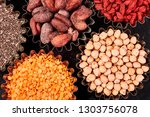 various superfoods in small... | Shutterstock . vector #1303756078
