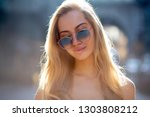 luxury young woman with long... | Shutterstock . vector #1303808212