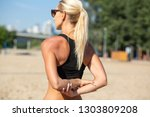 fitness tanned woman stretching ... | Shutterstock . vector #1303809208