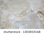 outdoor shot of cracked grey... | Shutterstock . vector #1303810168
