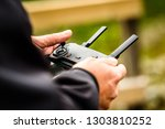 hand holding drone quadcopter... | Shutterstock . vector #1303810252