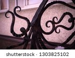 forged elements adorning metal... | Shutterstock . vector #1303825102