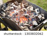 brazier with the burning coals | Shutterstock . vector #1303832062