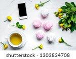 trendy office desk with roses...   Shutterstock . vector #1303834708