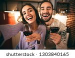 beautiful happy young couple... | Shutterstock . vector #1303840165