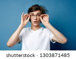 a man with disheveled hair in...   Shutterstock . vector #1303871485