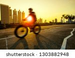 man riding sport bicycle in... | Shutterstock . vector #1303882948
