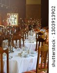 beautiful event tables setting... | Shutterstock . vector #1303913902