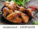 roasted chicken wings in hot... | Shutterstock . vector #1303916458