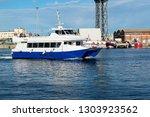 catamaran sails to the port of... | Shutterstock . vector #1303923562