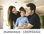 a father and a mother hugging... | Shutterstock . vector #1303932322