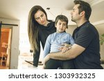 a father and a mother hugging... | Shutterstock . vector #1303932325