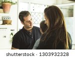a father and a mother hugging... | Shutterstock . vector #1303932328