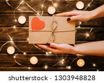 female gives a gift card... | Shutterstock . vector #1303948828