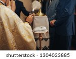 priest blessing with holy water ... | Shutterstock . vector #1304023885